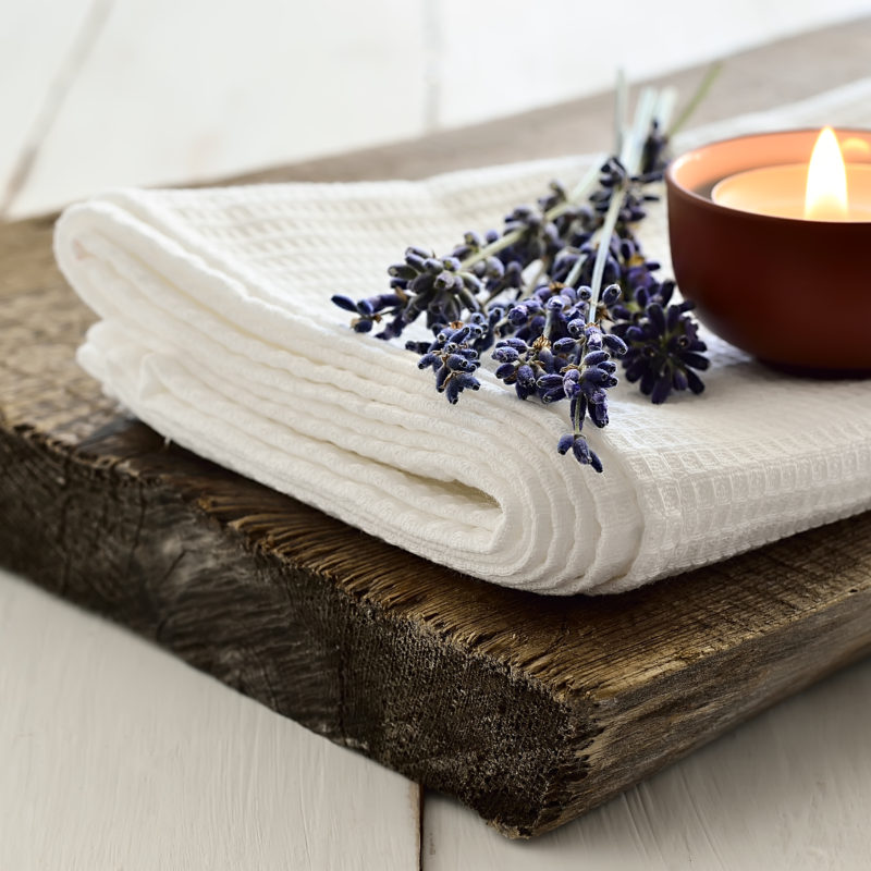 Spa set with aroma lavender candle. Selective focus